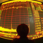 WUHAN, CHINA - MAY 28: (CHINA OUT) An investor views stock prices on monitors at a securities company on May 28, 2007 in Wuhan of Hubei Province, China. Chinese stocks hit new highs today with the benchmark Shanghai Composite Index closing at 4,272.11 points, up 2.21 percent, as the total number of share trading accounts in the country topped 100 million. In the last two weeks, the China Securities Regulatory Commission (CSRC) have issued a second warning for securities firms and related authorities to educate individual investors on risks associated with the booming Chinese stock market.  (Photo by China Photos/Getty Images)