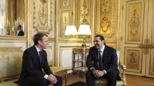 French President Emmanuel Macron, left,    confers with Lebanon's Prime Minister Saad Hariri at the Elysee palace in Paris, Saturday, Nov. 18, 2017. Hariri arrived in France on Saturday from Saudi Arabia and may be back in Beirut next week, seeking to dispel fears that he had been held against his will and forced to resign by Saudi authorities.(Pool Photo via AP)