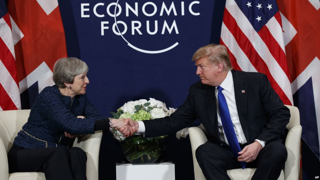 President Donald Trump meets with British Prime Minister Theresa May at the World Economic Forum, Thursday, Jan. 25, 2018, in Davos. (AP Photo/Evan Vucci)