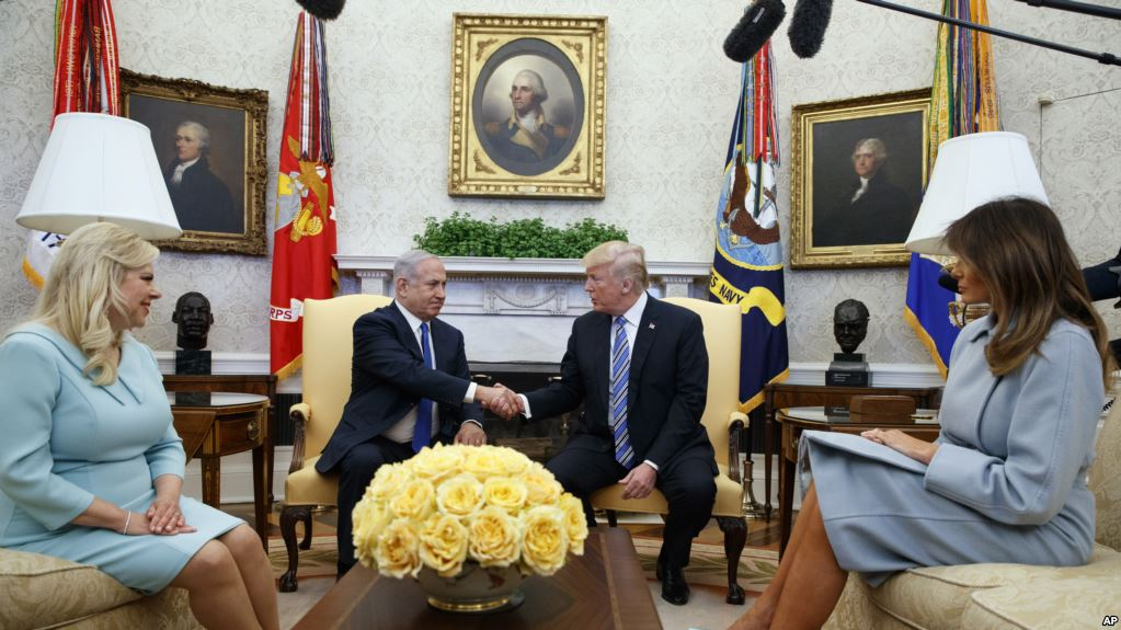 President Donald Trump and first lady Melania Trump meet with Israeli Prime Minister Benjamin Netanyahu and his wife Sara Netanyahu in the Oval Office of the White House, Monday, March 5, 2018, in Washington. (AP Photo/Evan Vucci)
