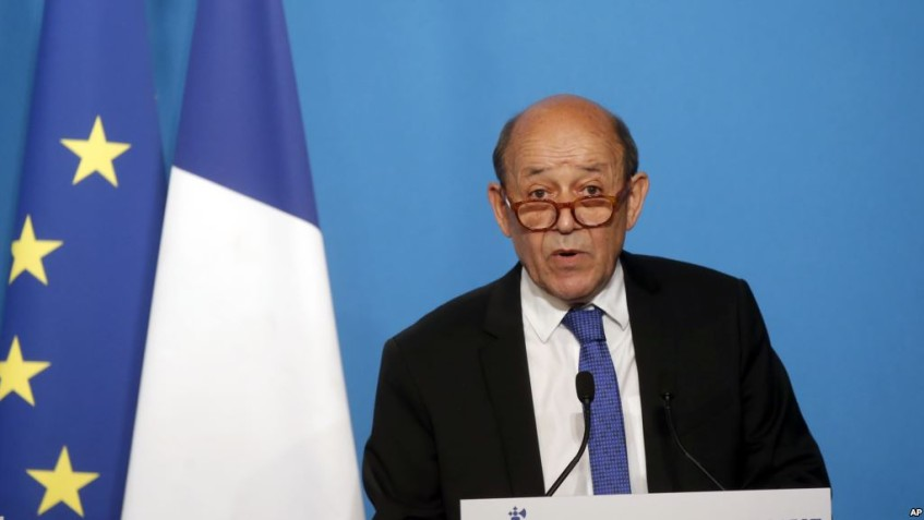 French Minister for Foreign Affairs Jean-Yves Le Drian gives an official statement in the press room after attending an emergency meeting with French President Emmanuel Macron at the Elysee Palace, in Paris, France, Saturday, April 14, 2018. The United States, France and Britain have launched military strikes in Syria to punish President Bashar Assad for an apparent chemical attack against civilians and to deter him from doing it again. (AP Photo/Michel Euler, Pool)