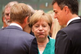 TOPSHOT - Germany's Chancellor Angela Merkel (C) reacts as she speaks with European Council President Donald Tusk (L) and Spain's Prime Minister Pedro Sanchez during an European Union leaders' summit focused on migration, Brexit and eurozone reforms on June 28, 2018 at the Europa building in Brussels. - The two-day meeting in Brussels is expected to be dominated by deep divisions over migration, with German Chancellor saying the issue could decide the fate of the bloc itself. (Photo by Ludovic MARIN / AFP)        (Photo credit should read LUDOVIC MARIN/AFP/Getty Images)
